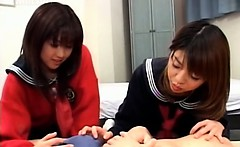Smiling asian teen girls sharing a horny dude in 3some