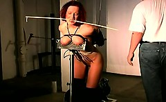 Beautiful redhead with beautiful tits gets tied and tortured