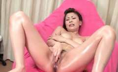 Solo asian girl has her oily pussy stimulated