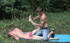 Teen boy enjoys butt spanking in the woods