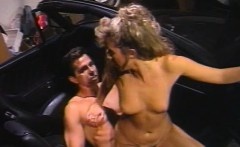 Peter North fucks a hot blond slut in a parked car
