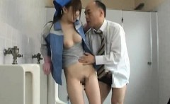 Asian beauty is cleaning the mens room