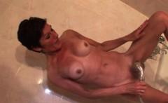 Hot mature masturbating with shower head