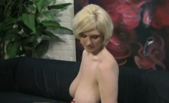 Hot blonde with big tits gives a handjob