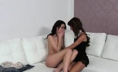 Slim female agent rubs pussy