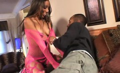 Wild ebony girl in pink fishnets gets banged by a black guy on the bed