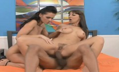 Two bodacious brunettes share their passion for black meat on the bed