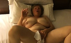 Busty mature lady having an orgasm