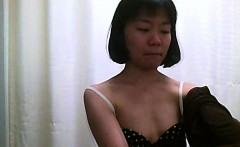 Hidden cam shoots Asian chicks with small tits changing in
