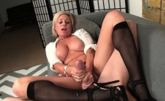 Busty milf tugging cock in sexy kneehighs