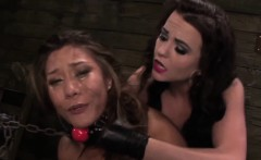 Strapon fucked asian les throated in trio