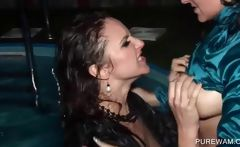 Clothed lesbos get wet in the pool