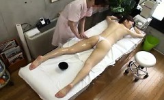 Elegant Oriental lady has a masseuse greasing up her marvel