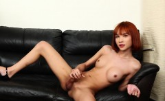 Ginger ladyboy jerks off and shows her hole