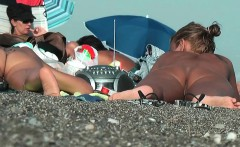 sexy nudist babes filmed playing on the nude beach