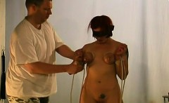 naked wife stands tied up and endures heavy breast thraldom