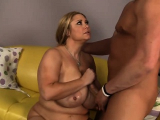 Girl with massive tits blowing big cock