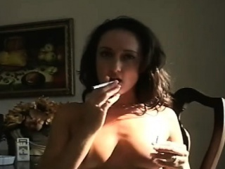 Mature doxy blows a lad while smoking a cigarette