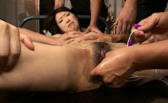 Bunch of dudes stimulates restrained skinny body and pussy