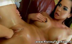 Brunette receives her friends fist into her very moist