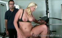Gorgeous blond MILF rides sons black friend in gym