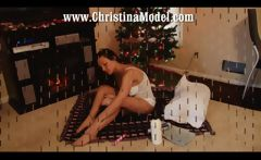 Busty brunette Christina M. is using a dildo to masturbate