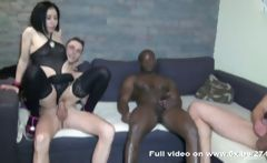 Brunette Gwenn is in a gangbang and gets fucked while