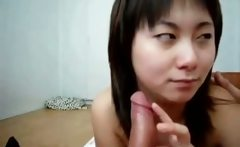 Cute asian babe blows stiff cock