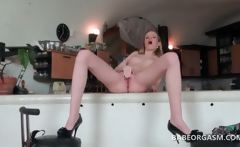 Blonde temptress gets naked and rubs her bald pussy