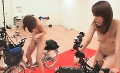 Asian naked teen with dildo inside of her riding a bike