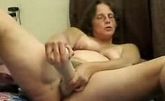 Mature housewife Caroline plays with big toys