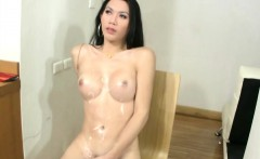 Teen ladyboy exposes her lush tits and jerks cock in mirror