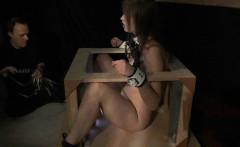 Enslaved slut big tits punishment in the bondage cage
