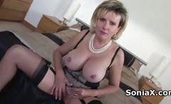 Sexy mature in lingerie rubbing clitoris