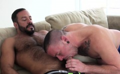 Inked bear jerks off with a cock in his mouth