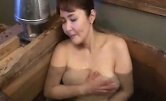 Lustful Japanese lady with big natural hooters makes hersel