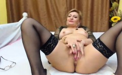 Mature blonde in stockings dildos her sweet cunt