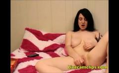 Cute brunette teen fingers her pussy