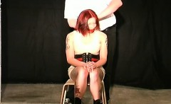Bare female stands obedient and endures harsh bdsm
