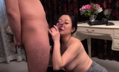Charming asian receives pussy toying while sucking shlong