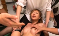 Pretty teacher bends down to shows off her big cleavage