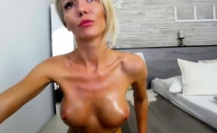 Blonde MILF with huge boobs is dominated