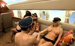 First class passengers having fun with sexy stewardess
