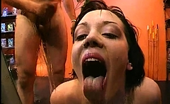 Breasty darling gets pussy and face pissing from two lads