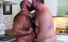 Two fat guys with sexy bellies fucking in the kitchen