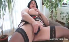 Busty mature BBW tries sex toys in hairy snatch