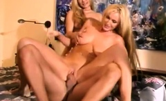 Classy clothed lesbian threesome toy and lick each other