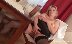 Stockinged mature hottie rubbing pussy on a chair